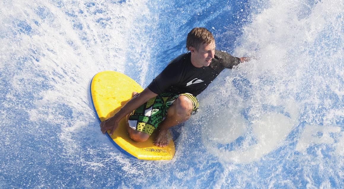 boy surfing on wave rider ride