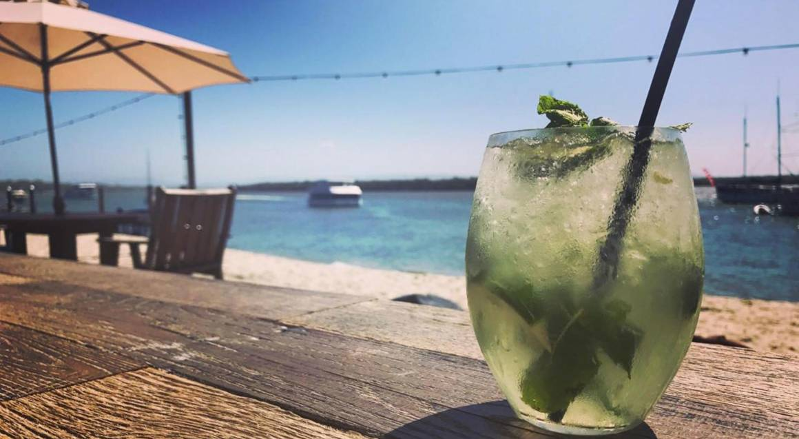 mojito cocktail with view of tropical beach