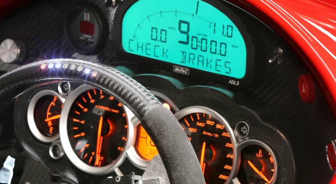 hypercar ride red hyoercar speedometer and steering wheel