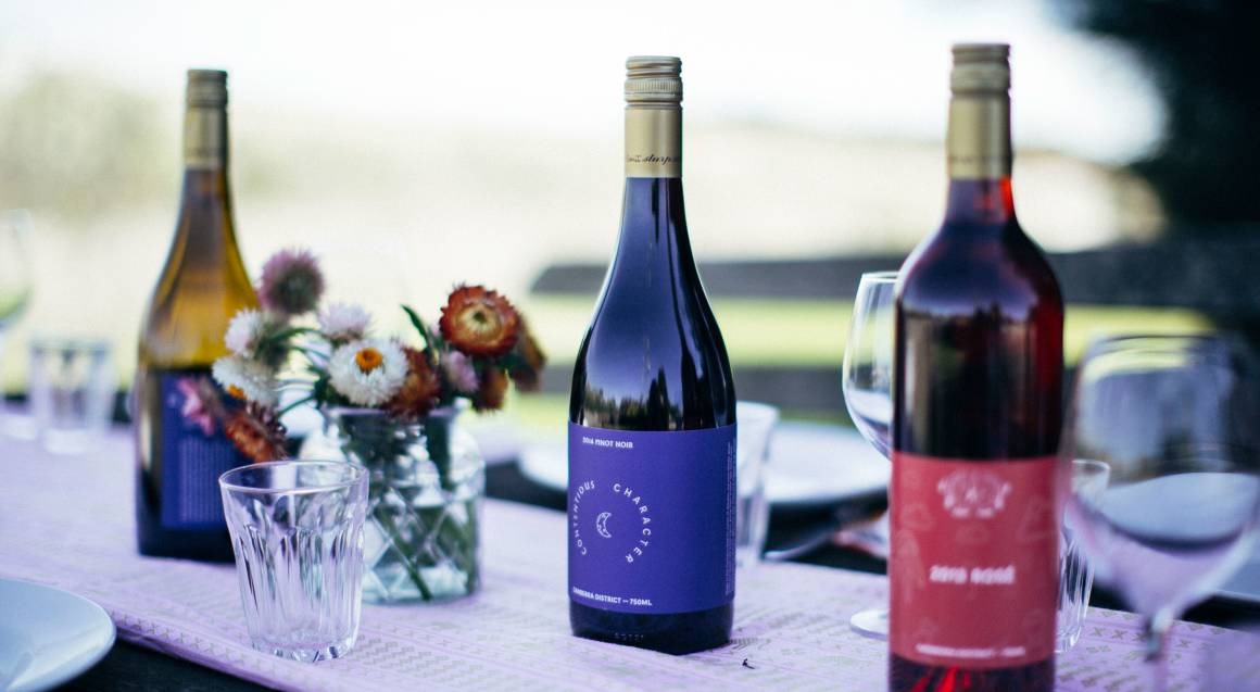 Contentious Character bottles of wine on outdoor table
