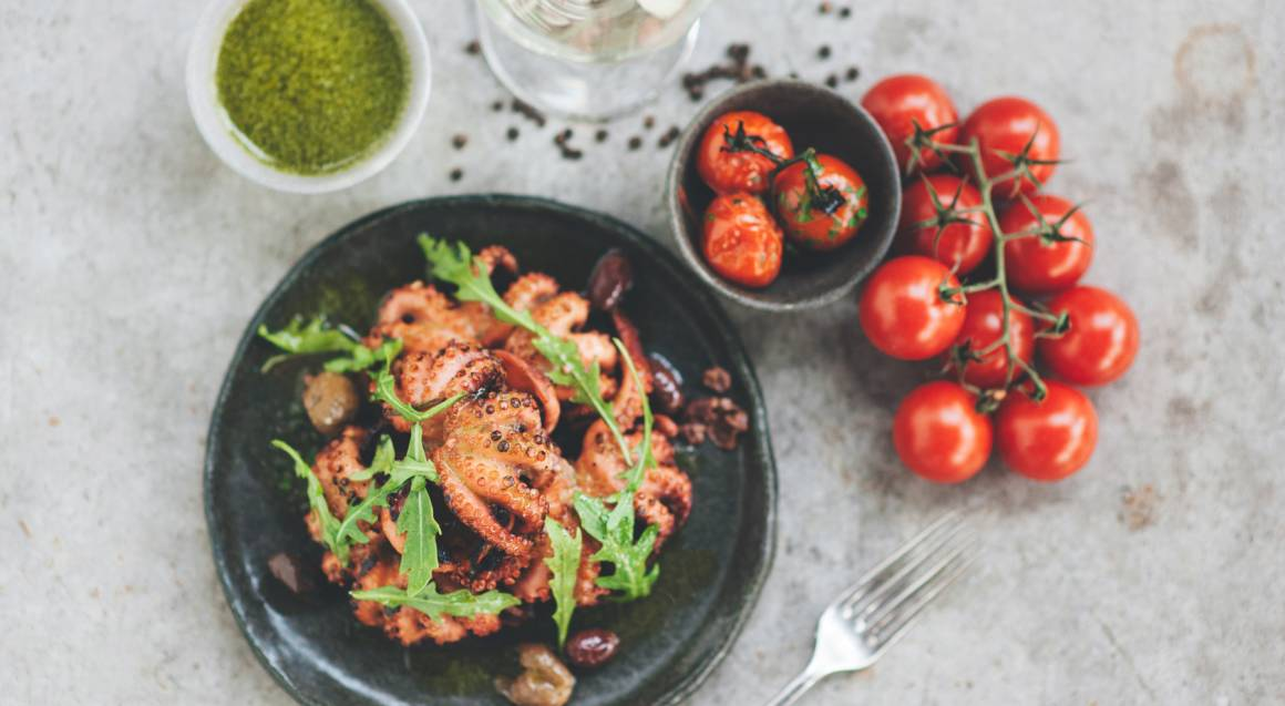 bowl of grilled octopus with cherry tomatos