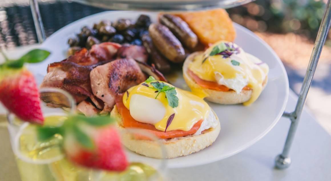 breakfast platter eggs benedict served on toasted Turkish bread