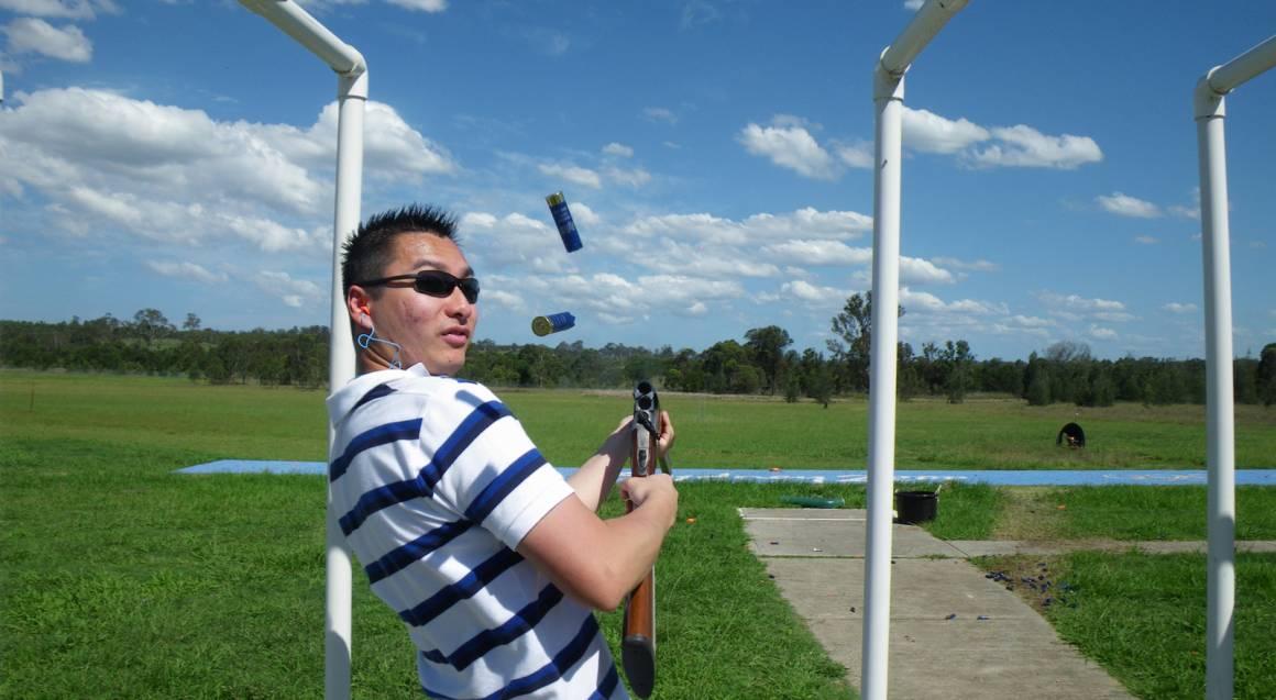 Hitting Targets clay target shooting with live ammo man shooting gun
