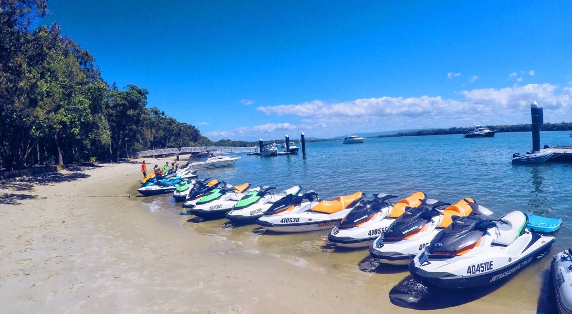 jet skis lined up on beach