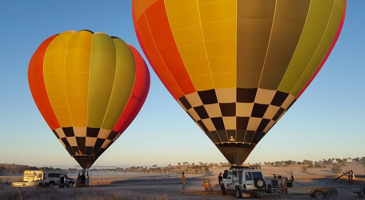 two hot air balloons departing orange