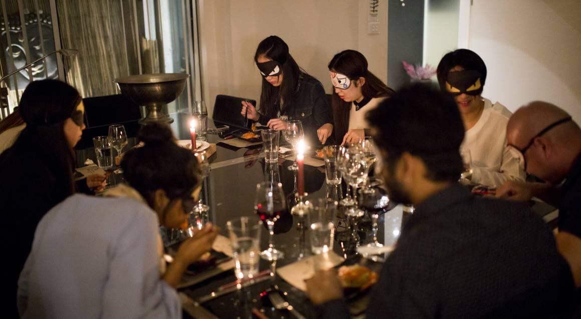 chefin group enjoying dinner blindfolded
