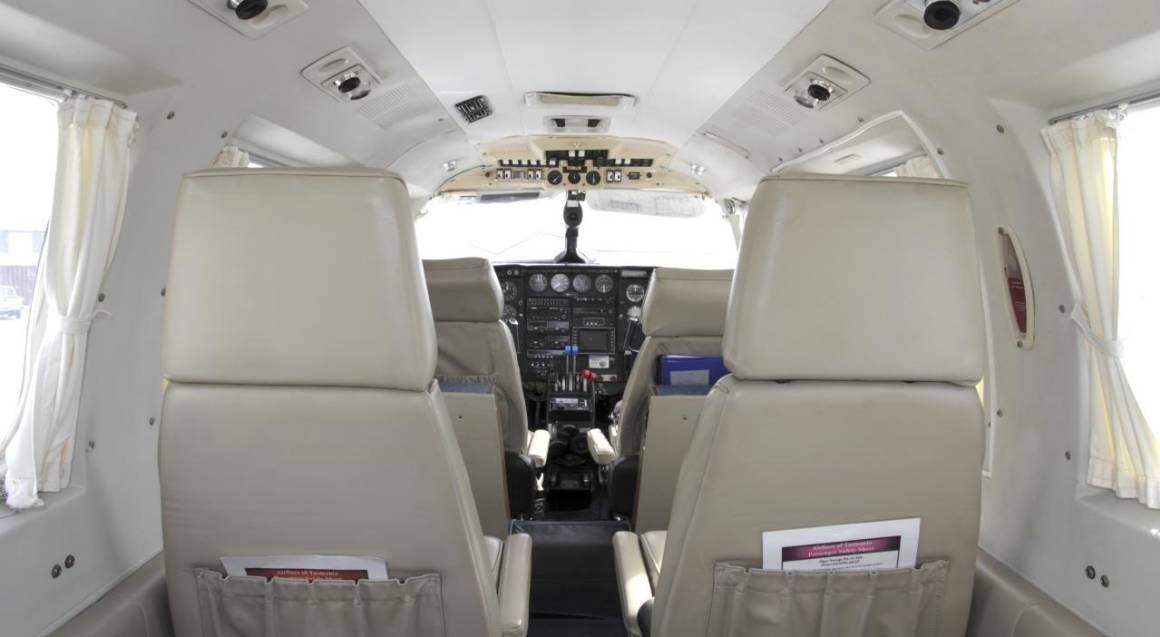 cockpit and four seats inside modern training aeroplane