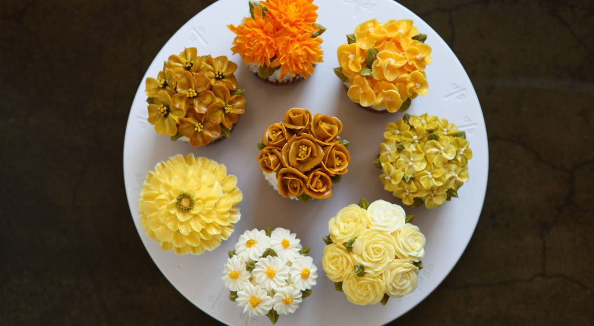 sugar flower cupcakes on a plate yellow and orange