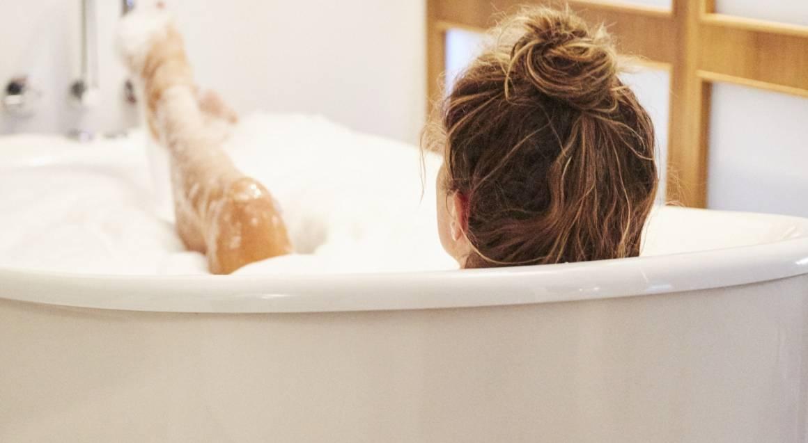 woman sitting in a bubble bath