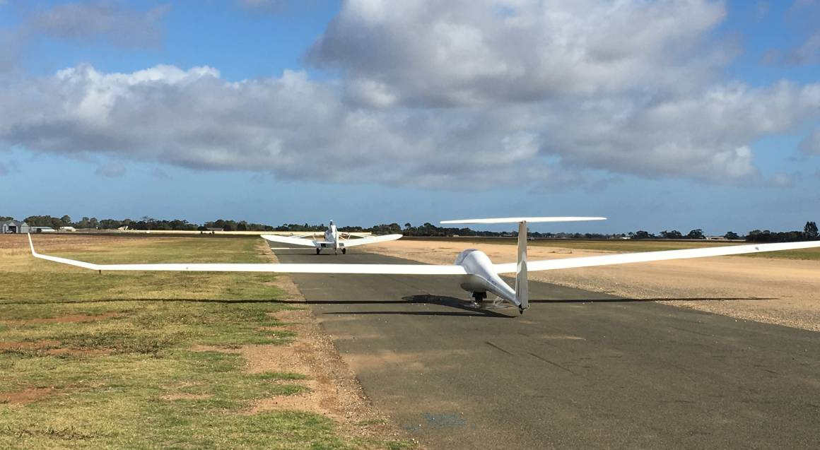glider plane on runway ready to take off