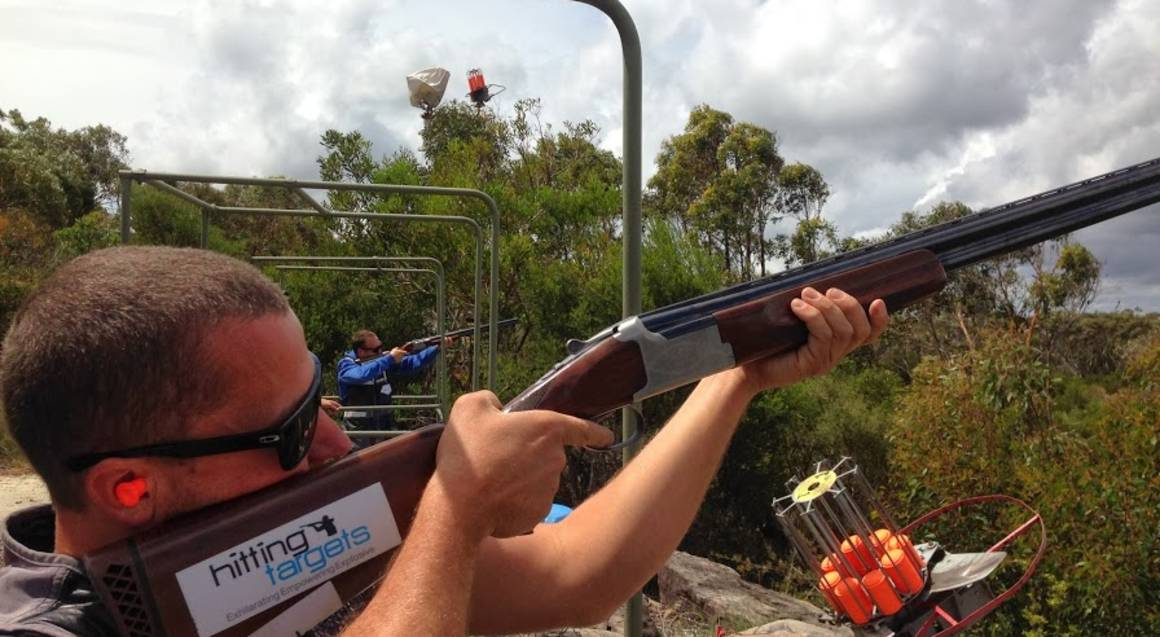 Hitting Targets clay target shooting with live ammo man aiming and shooting gun