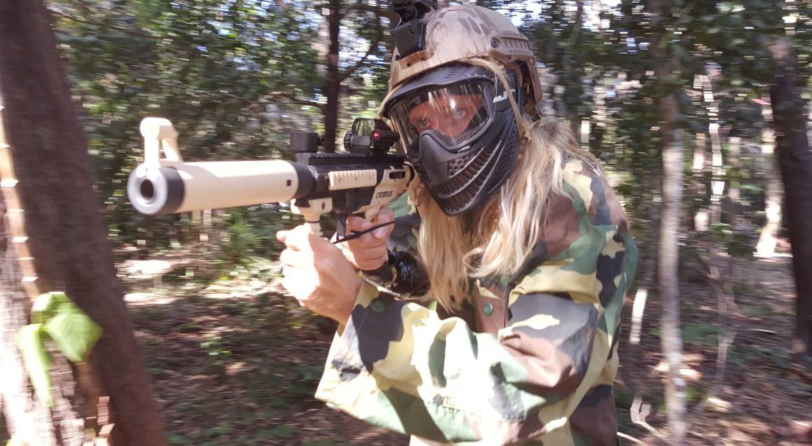 Xperiences Paintball sunshine coast man aiming gun bushland