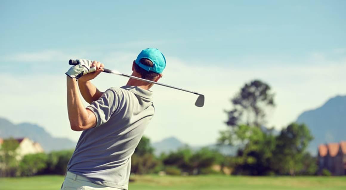 St Michaels Golf Club man playing golf swinging club
