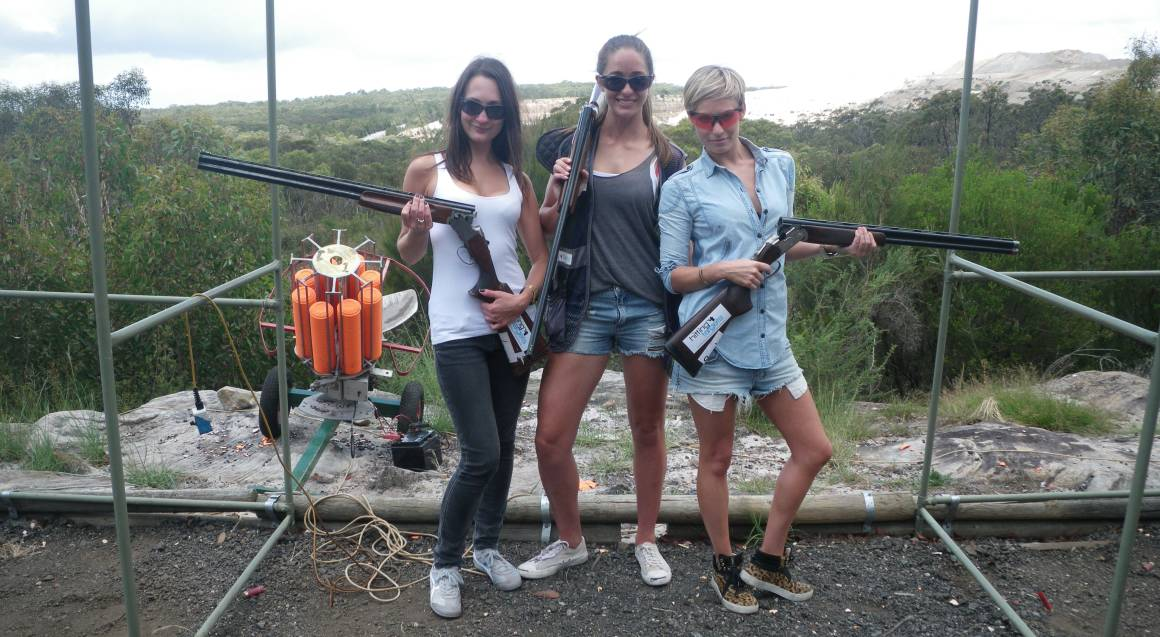 Hitting Targets clay target shooting with live ammo man shooting women posing with guns
