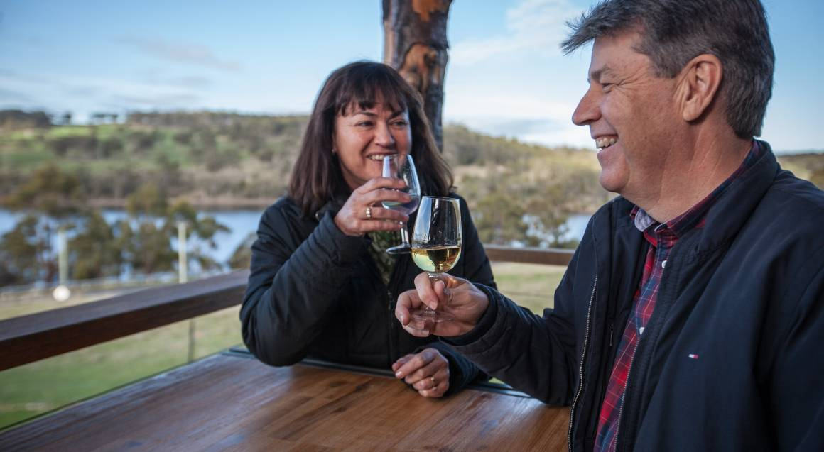 couple enjoying a glass of tasmanian wine