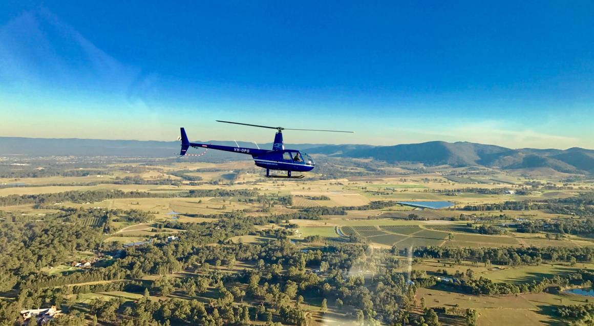 helicopter flying over hunter valley
