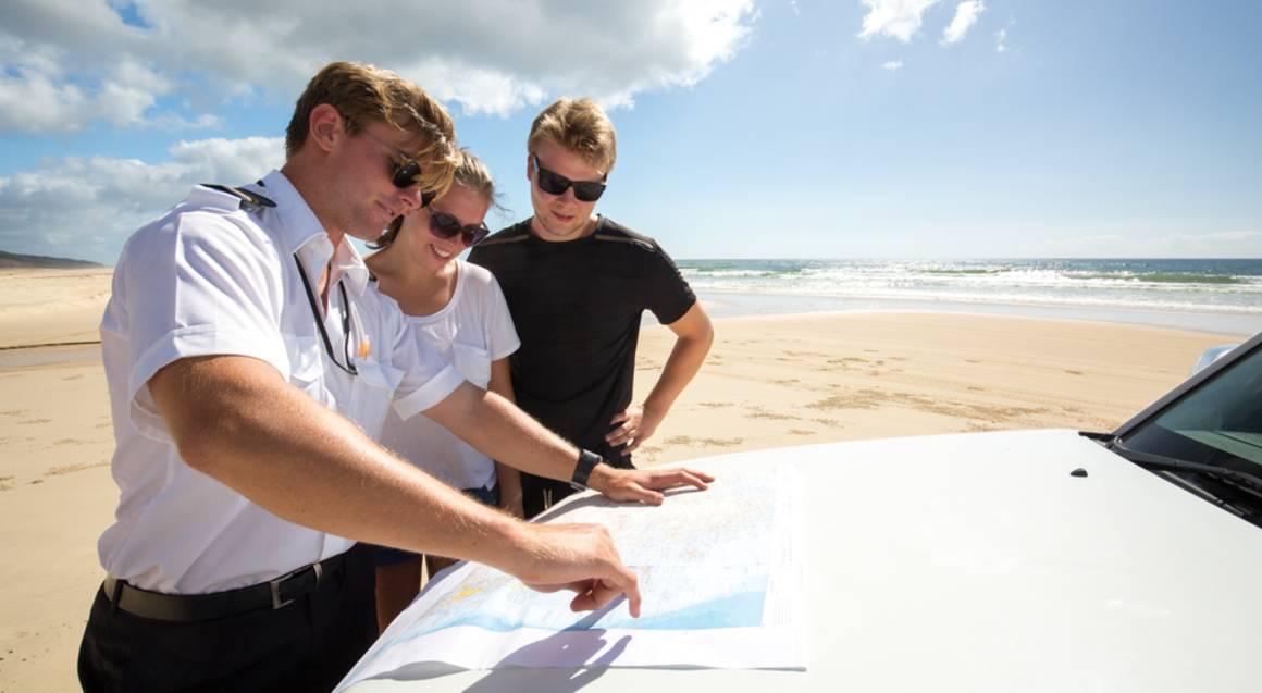 fraser island beach pilot and tourists