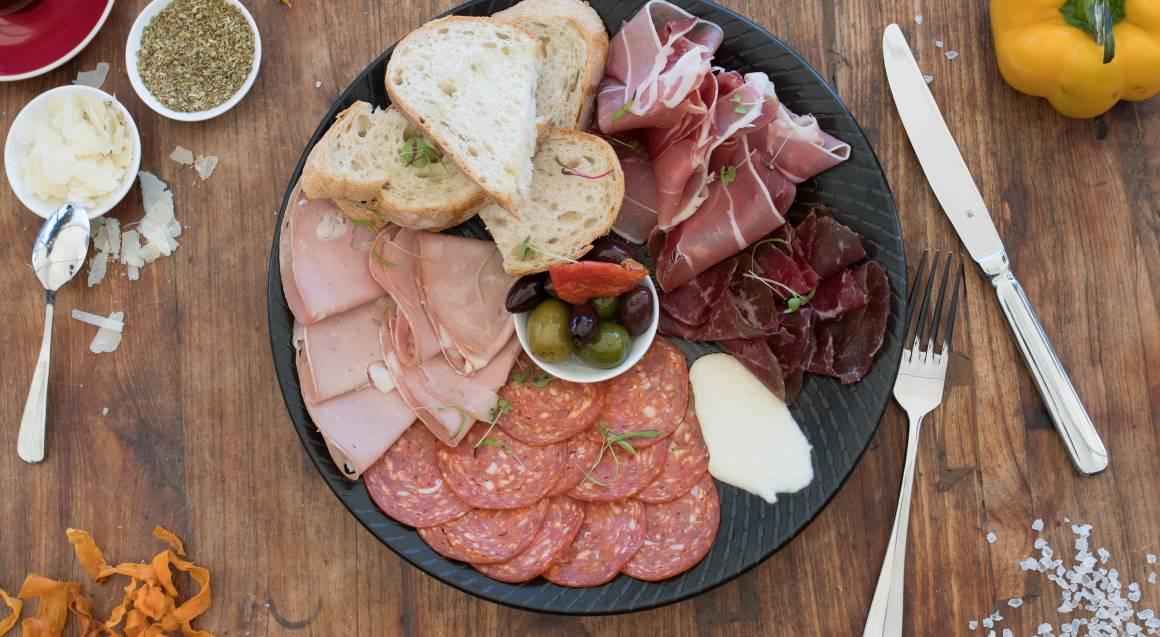 italian antipasto platter of salami ham prosciutto and bread