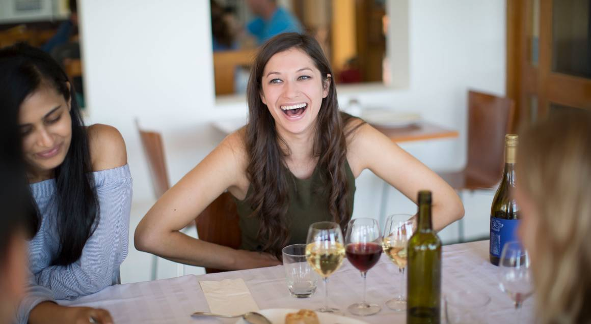 Contentious Character woman eating in restaurant with wine