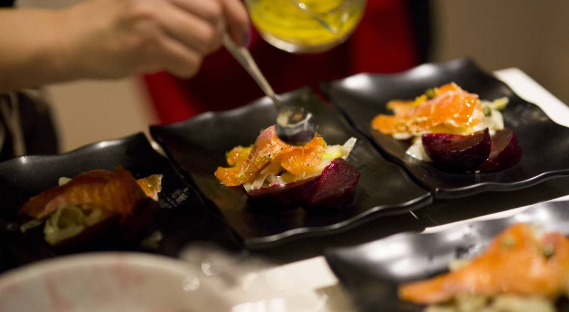 Chefin chef serving up smoked salmon dish