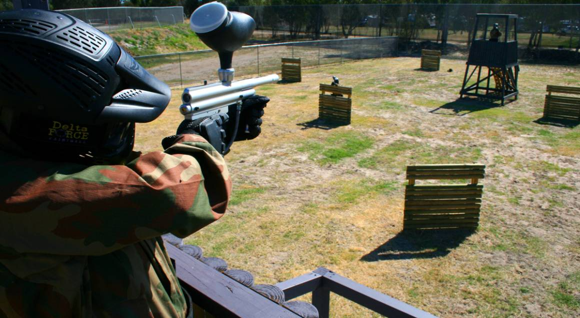 man playing paintball on field bonneys perth