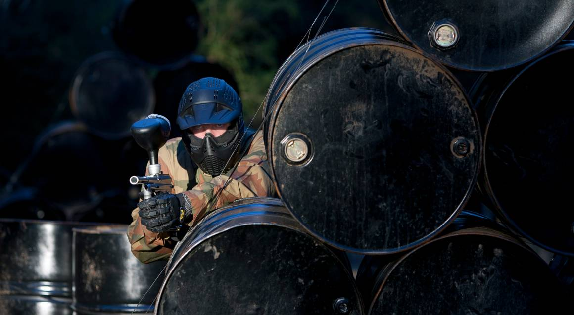 Delta Force Paintball man aiming gun