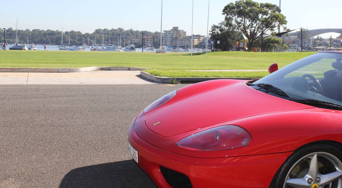 Fuga Veloce front of red ferrari 360 spider parked on road