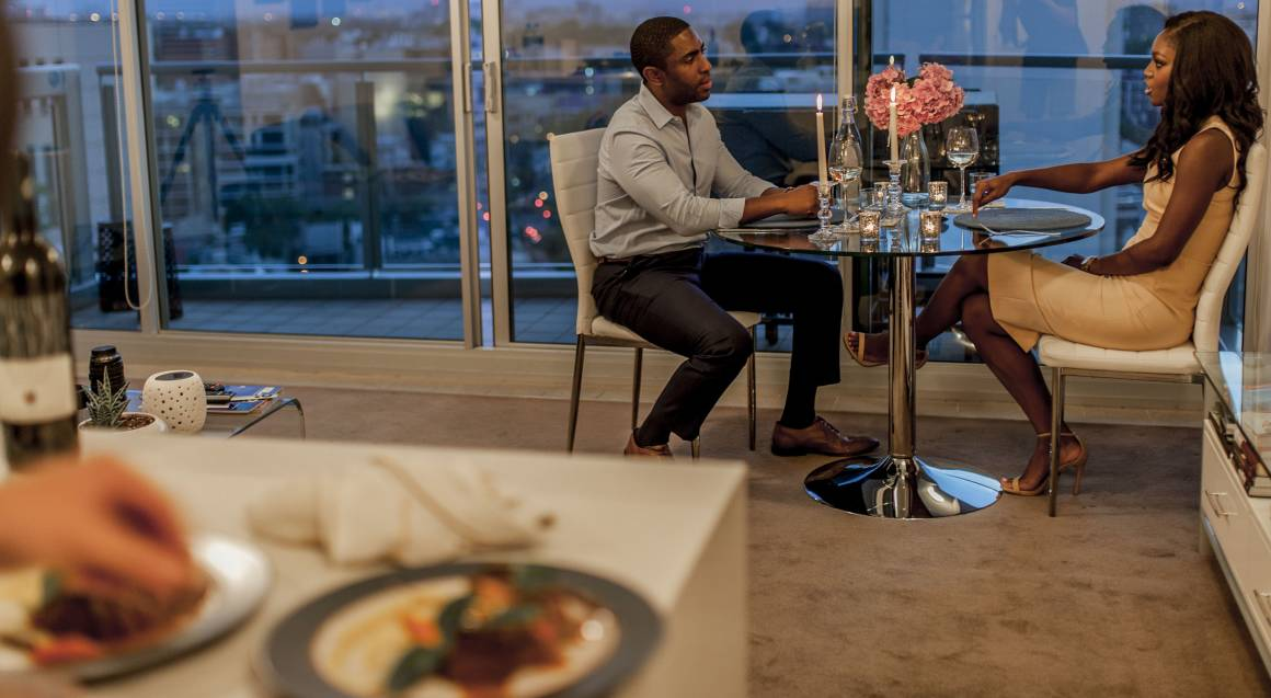 couple enjoying dinner at home cooked by private chef