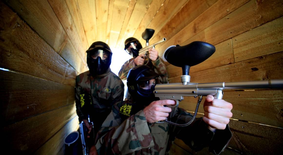 men playing paintball aiming guns bonneys perth