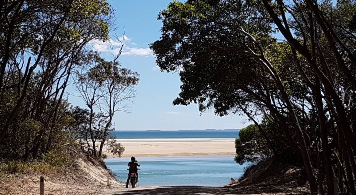 Dirt bike hire Sunshine Coast Queensland beach scenic view and motorcyclist