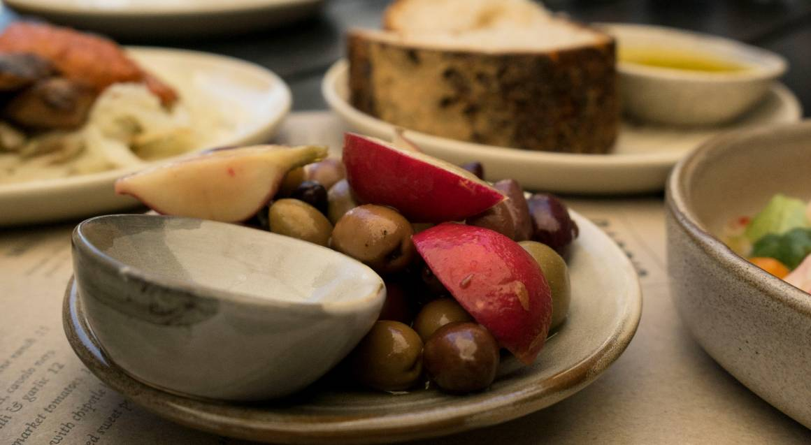 local produce plate of olives and apple