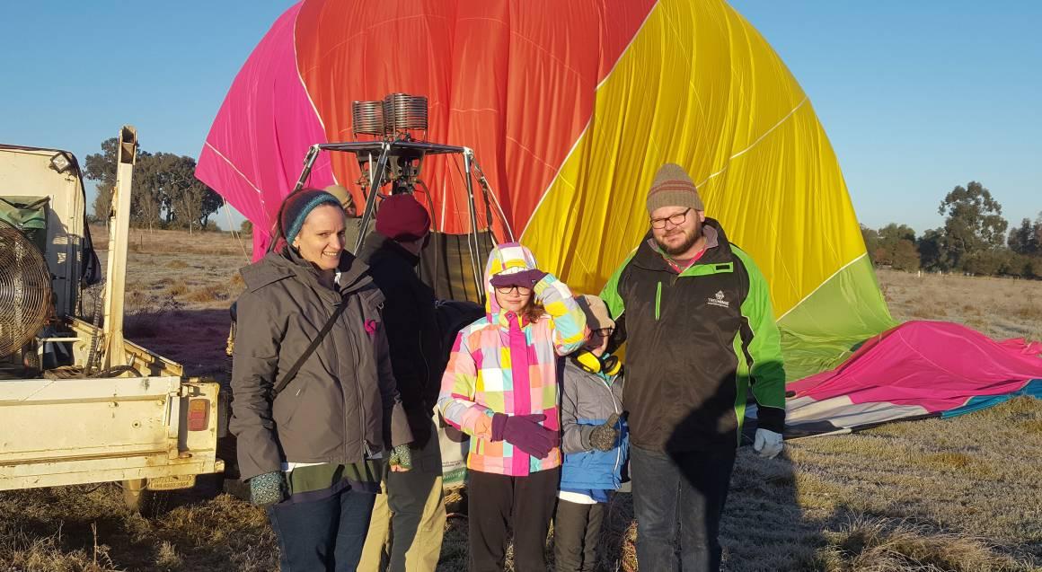family with hot air balloon deflating orange