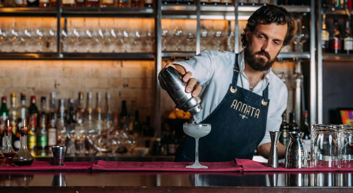 bartender making cocktail at annata restaurant crows nest