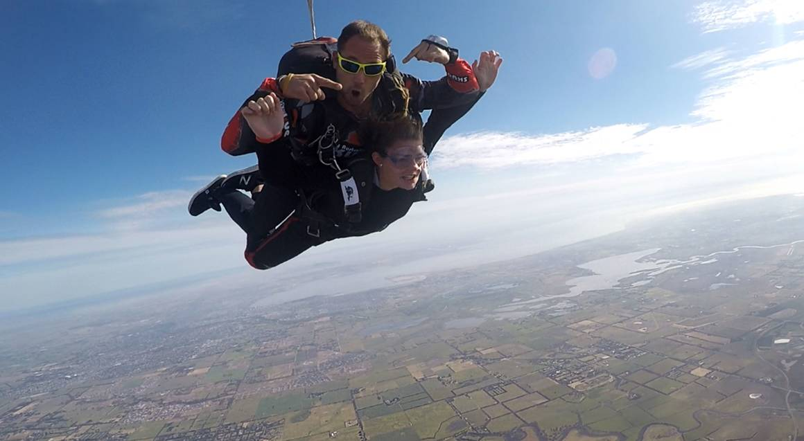 man and instructor tandem skydiving over great ocean road victoria