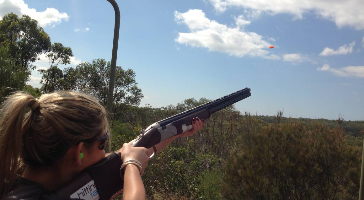 Hitting Targets clay target shooting with live ammo man aiming and shooting at target