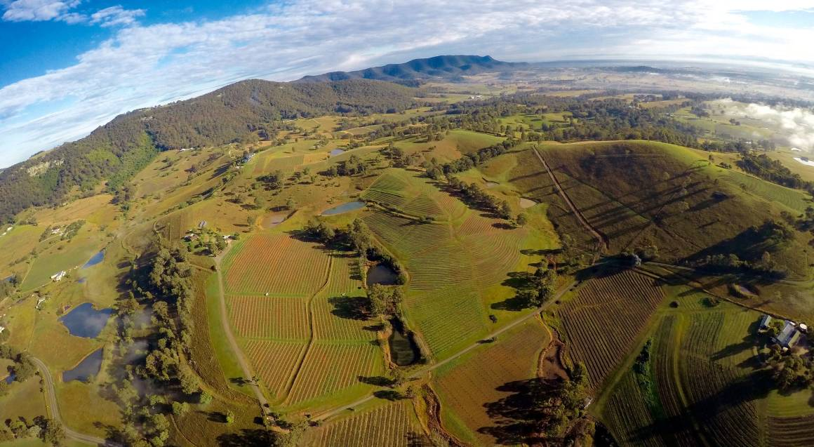 helicopter flying over hunter valley aerial view