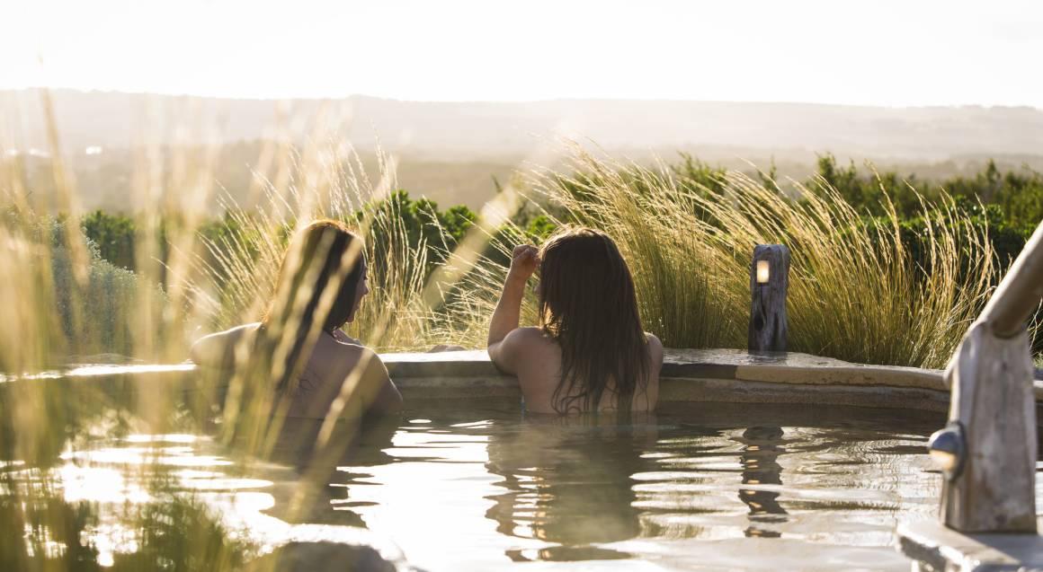 two people in hot springs bath