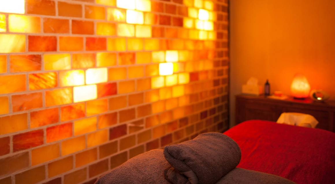 saltuary inside day spa massage treatment room with bed