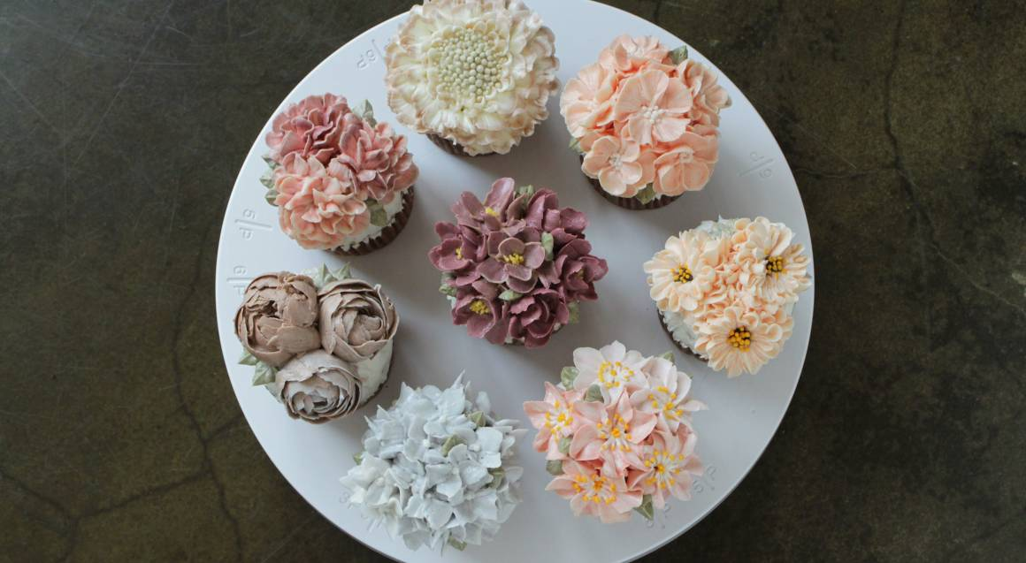 sugar flower cupcakes on a plate pastel colours