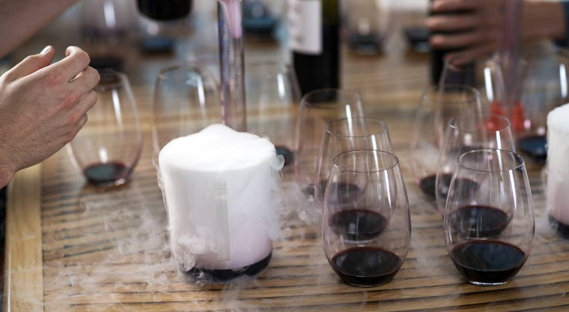 table with glasses of red wine for wine blending