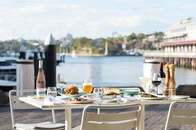 A dinner table with views of Sydney Harbour