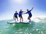 Family surfing in Byron Bay
