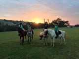 Kids horse riding at sunset