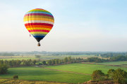 hot air balloon flying over the countryside