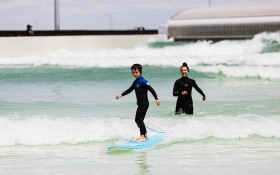 Young boy surfing at URBNSURF, Melbourne