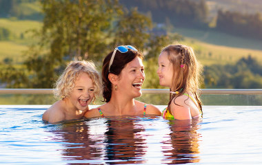 Mother and children in swimming pool