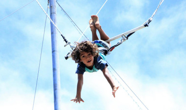 Young boy on trapeze at Sydney circus school