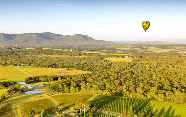 Hot air balloon flying over the Hunter Valley