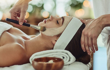 Woman getting facial at day spa