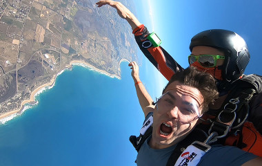 Man tandem skydiving over the Great Ocean Road